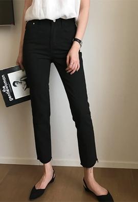 Cutting black pants